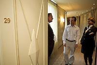 Switzerland. Canton Graubünden. St. Moritz. Hotel Carlton.  Stefan Kleinat (L), butler, and Franziska Titze (R) welcome a guest (C) to his suite. © 2008 Didier Ruef