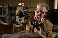 BNPS.co.uk (01202) 558833. <br /> Pic: CorinMesser/BNPS<br /> <br /> Pictured: Richard Bromell of Charterhouse Auctioneers with an aircraft radio, c1941, and a radio operators headset. <br /> <br /> Radio Ga-Ga..<br /> <br /> A vast collection of vintage radios, televisions and record players have emerged for sale at auction following the death of their owner.<br /> <br /> The group, which consists of hundreds of old-school electronics, was amassed over several decades by an eccentric and dedicated collector.<br /> <br /> An electrician by trade, he housed the goods in a private museum near Dorchester in Dorset but rarely displayed them to the general public.