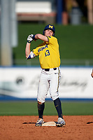 Michigan Wolverines designated hitter Dominic Clementi (13) gestures to teammates after hitting a double during a game against Army West Point on February 17, 2018 at Tradition Field in St. Lucie, Florida.  Army defeated Michigan 4-3.  (Mike Janes/Four Seam Images)