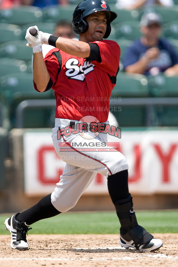Nashville Sounds shortstop Luis Figueroa #9 swings against the Round Rock Express in Pacific Coast League baseball on May 9, 2011 at the Dell Diamond in Round Rock, Texas. (Photo by Andrew Woolley / Four Seam Images)
