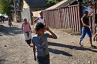 """ROMANIA, Tulcea, Taberei quarter, 2010/08/24.Half of the Roma families living in the district of Tulcea Viitorului, bordering the former industrial conglomerate, lives in France. This area is one of the poorest in the city without running water and sometimes no electricity. The street of """"future"""" is always paved. The families live mainly social benefits and hope all from one day to join Roma in Saint-Denis (France). .© Bruno Cogez / Est&Ost Photography..Roumanie, Tulcea, quartier de Taberei, 24/08/2010.La moitié des familles roms vivant dans le quartier Taberei de Tulcea, en bordure de 'lancien combinat industriel, vit en France. Ce quartier est un des plus pauvre de la ville, sans eau courante et parfois sans électricité. Les familles vivent principalement des allocations sociales et espèrent toutes partir un jour rejoindre les Roms de Saint-Denis..© Bruno Cogez / Est&Ost Photography"""