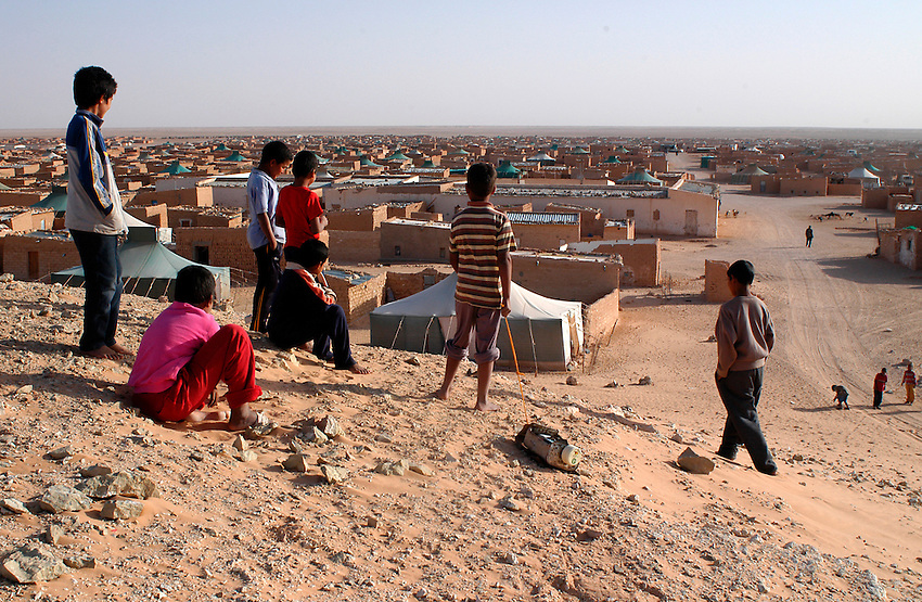 Children play on December 11, 2003, in the Saharawi refugee camps. Saharawi people have been living at the refugee camps of the Algerian desert named Hamada, or desert of the deserts, for more than 30 years now. Saharawi people have suffered the consecuences of European colonialism and the war against occupation by Moroccan forces. Polisario and Moroccan Army are in conflict since 1975 when Hassan II, Moroccan King in 1975, sent more than 250.000 civilians and soldiers to colonize the Western Sahara when Spain left the country. Since 1991 they are in a peace process without any outcome so far. (Ander Gillenea / Bostok Photo)