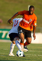 Chris Basham of the Bolton Wanderers defends against Darren Toby during a match at UNCC in Charlotte, NC.  The Charlotte Eagles currently in 3rd place in the USL second division played a friendly against the Bolton Wanderers from the English Premier League on 7/14/10 losing 3-0.