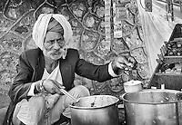 Preparing chai (masala tea)<br /> A scene from the Pushkar Camel Fair <br /> Rajasthan, India.
