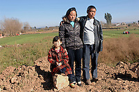 Mrs. Hu Ye Qin,33, Mr. Huang He, 37,  and one of their daughters, He Lun - 7 years old. the parents were sterilized by force ,  the husband with no anesthetic for not being able to the fine for having too many children.<br /> ©sinopix