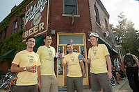 "The 24hr Champagne Team drinking Miller High LIfe, ""The Champagne of Beers"" before the start of the ride"