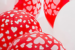Red and white balloons with heart-shaped pattern