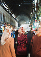 Shopeers walk through the Al-Hamidiyah Souq in Damascus, Syria
