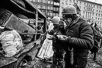 Protesters have a frugal meal during a cease fire