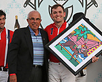 WELLINGTON, FL - NOVEMBER 25:  Retired WPTV anchor Jim Sackett presents the awards to the teams. Shown here with Grant Ganzi. Scenes from  the USPA International Cup at the Grand Champions Polo Club, on November 25, 2017 in Wellington, Florida. (Photo by Liz Lamont/Eclipse Sportswire/Getty Images)