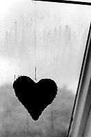 Germany. Hamburg. A black heart on a rope. Rain on the window. Gray day. 22.05.13  © 2013 Didier Ruef