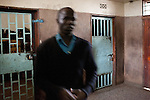A police guard outside of the holding cells at Nairobi Central Police Station.