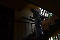 MEDELLIN - COLOMBIA, 20-04-2020: Jornada de desinfección en la urbanización Loyola del barrio Buenos Aires de Medellín durante el día 28 de la cuarentena total en el territorio colombiano causada por la pandemia  del Coronavirus, COVID-19. / Desinfection journey in the Loyola urbanization of the Buenos Aires neighborhood of Medellin of during day 28 of total quarantine in Colombian territory caused by the Coronavirus pandemic, COVID-19. Photo: VizzorImage / Leon Monsalve / Cont