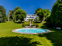 BNPS.co.uk (01202) 558833.<br /> Pic: Savills/BNPS<br /> <br /> Pictured: Gardens and swimming pool.<br /> <br /> A controversial and iconic country house that appeared in TV's Poirot is on the market for £2.5m.<br /> <br /> The quirky Y-shaped High and Over was met with disdain from the public and local planners when it was built in 1929-31.<br /> <br /> But the Grade II* listed building is now widely considered to be the first and finest house built in the Modernist style in Britain.<br /> <br /> The six-bedroom property in Amersham, Bucks, was also used in ITV's Poirot as the home of villain Henry Reedburn in The King of Clubs.