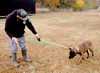 Marc Hayot/Herald Leader Zeke Johnson leads his K9 partner Duke to a sight that may contain drugs.