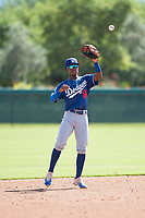 Los Angeles Dodgers shortstop Eddys Leonard (84) waits to receive a throw during an Instructional League game against the Oakland Athletics at Camelback Ranch on October 4, 2018 in Glendale, Arizona. (Zachary Lucy/Four Seam Images)