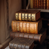 Leather-bound bibles are stacked in a corner of this library