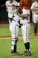Delmarva Shorebirds catcher Adley Rutschman (37) embraces relief pitcher Ruben Garcia (18) after closing out a South Atlantic League game against the Greensboro Grasshoppers on August 21, 2019 at Arthur W. Perdue Stadium in Salisbury, Maryland.  Delmarva defeated Greensboro 1-0.  (Mike Janes/Four Seam Images)