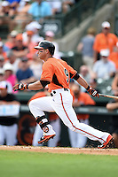 Baltimore Orioles outfielder David Lough (9) during a spring training game against the Pittsburgh Pirates on March 23, 2014 at Ed Smith Stadium in Sarasota, Florida.  Baltimore and Pittsburgh tied 7-7.  (Mike Janes/Four Seam Images)