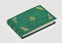 BNPS.co.uk (01202) 558833<br /> Pic: PeterHarrington/BNPS<br /> <br /> The green leather bound manuscript has 31 pages<br /> <br /> A unique miniature Harry Potter book created by JK Rowling has emerged for sale for £125,000.<br /> <br /> The author hand-wrote and illustrated the 31 page green leather bound manuscript measuring just 1.5ins by 2.5ins for a charity auction in 2004.<br /> <br /> It contains the passage on pages 52-53 of Harry Potter and The Philosopher's Stone where Harry and Hagrid go to London to buy school supplies for Hogwarts.<br /> <br /> Rowling has done original drawings of equipment including quills, scales, a cauldron and a wizard's hat.