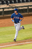 AZL Rangers right fielder Beder Gutierrez (8) jogs towards home plate after hitting a two-run home run in the top of the 12th inning of an Arizona League playoff game against the AZL Indians 1 at Goodyear Ballpark on August 28, 2018 in Goodyear, Arizona. The AZL Rangers defeated the AZL Indians 1 7-4. (Zachary Lucy/Four Seam Images)