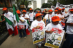 Demonstrators hold a banner against a privatization of Pemex while thousands of people march during a rally on main thoriughfares, April 27, 2008. Photo by Heriberto Rodriguez