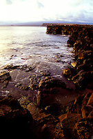 The rugged, rocky coastline of South Point at the southern tip of the Big Island of Hawaii.