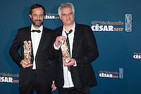 "Swiss film director Claude Barras (L) and French film director Fabrice Luang-Vija (R) pose with their trophy during a photocal after winning the Best Animated Feature award for ""Ma vie de Courgette"" (My Life as a Courgette) and ""Celui qui a deux ames"" (He Who Has Two Souls) during the 42nd edition of the Cesar Ceremony at the Salle Pleyel in Paris on February 24, 2017."