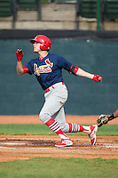 Hunter Newman (32) of the Johnson City Cardinals follows through on his swing against the Bristol Pirates at Boyce Cox Field on July 7, 2015 in Bristol, Virginia.  The Cardinals defeated the Pirates 4-1 in game one of a double-header. (Brian Westerholt/Four Seam Images)