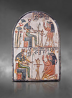 "Ancient Egyptian Ra stele , limestone, New Kingdom, 19th Dynasty, (1279-1190 BC), Deir el-Medina,  Egyptian Museum, Turin. Grey background.<br /> <br /> Akh iqer en Ra "" the excellent spirit of Ra' stele. One of three stele forund in different rooms of houses in Deir el-Medina where they stood in niches"