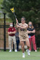 NEWTON, MA - MAY 16: Sydney Scales #45 of Boston College passes the ball during NCAA Division I Women's Lacrosse Tournament second round game between Temple University and Boston College at Newton Campus Lacrosse Field on May 16, 2021 in Newton, Massachusetts.