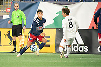 FOXBOROUGH, MA - OCTOBER 09: Nicolas Firmino #29 of New England Revolution II passes the ball as Blaine Ferri #8 of Fort Lauderdale CF comes in to tackle during a game between Fort Lauderdale CF and New England Revolution II at Gillette Stadium on October 09, 2020 in Foxborough, Massachusetts.