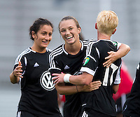 Marisa Abegg (5) of the D.C. United Women celebrates a goal with teammate Joanna Lohman (17) and Molly Menchel (14) during the game at the Maryland SoccerPlex in Boyds, Maryland.  The D.C. United Women defeated the Virginia Beach Piranhas, 3-0, to advance to the W-League Eastern Conference Championship.