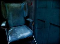 Blue chair by a blue door