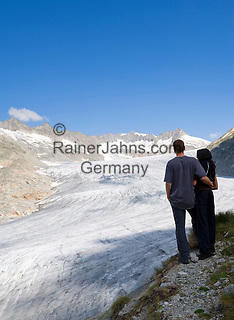 Switzerland, Canton Valais, Rhone Glacier with Gaerstenhoerner mountains above Furka Pass Road - couple