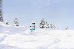 Snowboarder Emma Shapera ripping up deep December powder at Wolf Creek, Colorado