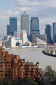 View towards the Isle of Dogs from Shadwell, showing new flats on The Highway in Limehouse, Canary Wharf, the HSBC and Citibank Towers, and the River Thames with Rotherhithe on its right bank.