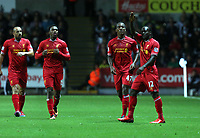 Pictured: Victor Moses (R) of Liverpool celebrating his goal with team mates, making the score 1-2. Monday 16 September 2013<br /> Re: Barclay's Premier League, Swansea City FC v Liverpool at the Liberty Stadium, south Wales.