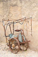 Chateau de Montpezat. Pezenas region. Languedoc. An old horse-drawn spraying cart rusting in a court yard. France. Europe.