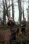 Childrens Shoot UK shooting Hampshire England Pheasant shoot.  Rural sport teaching kids about countryside sports Father and son 2000s