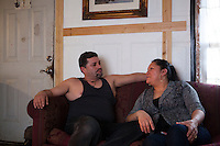 Esubio Moctezuma at home with his partner Esperanza Pacheco.  Moctezuma was seperated from his partner and their four children for two years from July 2011 to March 2013 after he was deported to Mexico. The courts reversed his deportation and he is a green card holder. Photo by Brendan Bannon, Painesville, Ohio. March 25, 2014