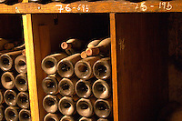 Old wine bottles aging in the wine cellar. Alain Voge, Cornas, Ardeche, Ardèche, France, Europe