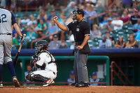 Umpire Jose Matamoros calls a strike behind catcher Richard Gonzalez during a game between the Brooklyn Cyclones and Tri-City ValleyCats on September 1, 2015 at Joseph L. Bruno Stadium in Troy, New York.  Tri-City defeated Brooklyn 5-4.  (Mike Janes/Four Seam Images)