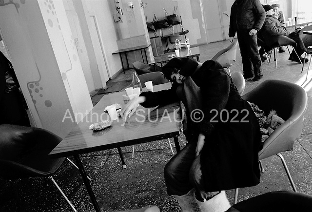 Rudichnii, Russia  .March 1999.At 9AM a woman already lies drunk on a table at the Kama Cafe..