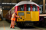 Pictured: Tony Long, a maintenance fitter for South West Trains buffs the departure board on the British Rail Class 483 Island Line train in the workshop at Ryde St Johns Road train station, Isle of Wight after its last passenger service on Sunday 3rd January 2021, ahead of being delivered to the Isle of Wight Steam Railway as the line prepares to unveil a new fleet of London Underground trains in the spring. <br /> <br /> The trains, which previously served the London Underground's Northern Line are estimated to have travelled over 3 million miles in their 82 years of service. The Island Line is currently undergoing 3 months of refurbishment ahead of unveiling a new fleet of trains, five British Rail Class 484, extensively refurbished by Vivarail.<br /> <br /> The previous two fleet service will see the train (pictured) being delivered to the Isle of Wight Steam Railway, and the other to the London Traction Transport Group with the intention of running it on the Epping Ongar Railway.<br /> <br /> In keeping with Island Line's traditions, the Class 484 trains are former London Underground trains which served on the District Line and will modernise the service on the island.<br /> <br /> © Jordan Pettitt/Solent News & Photo Agency<br /> UK +44 (0) 2380 458800