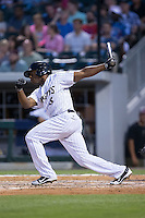 Jason Bourgeois (8) of the Charlotte Knights follows through on his swing against the Syracuse Chiefs at BB&T BallPark on June 1, 2016 in Charlotte, North Carolina.  The Knights defeated the Chiefs 5-3.  (Brian Westerholt/Four Seam Images)