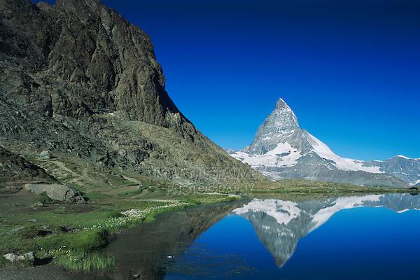Matterhorn reflecting in Riffelsee, Zermatt, Swiss Alps, Switzerland