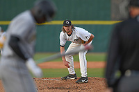 Starting pitcher Blake Whitney (14) of the University of South Carolina Upstate Spartans looks for the sign from catcher Charlie Carpenter in a game against the Kennesaw State Owls on Thursday, March 29, 2018, at Cleveland S. Harley Park in Spartanburg, South Carolina. (Tom Priddy/Four Seam Images)