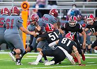 Landon Phipps (5) of Springdale<br /> gets tackled by Cooper Gardenhire (51) of Farmington<br />at Cardinals Stadium, Farmington, Arkansas on Friday, September 11, 2020 / Special to NWA Democrat-Gazette/ David Beach