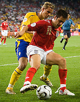 Niclas Alexandersson of Sweden (7) in action against Joe Cole (11) of England. England and Sweden played to a 2-2 tie in their FIFA World Cup Group B match at  FIFA World Cup Stadium, Cologne, Germany, June 20, 2006.